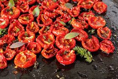 Sun dried tomatoes. With olive oil and herbs Stock Photo