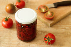 Sun dried tomatoes with olive oil in a jar Stock Image