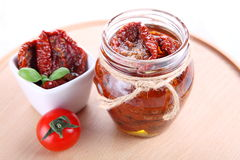 Sun dried tomatoes with olive oil in a jar Royalty Free Stock Photo