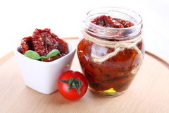 Sun dried tomatoes with olive oil in a jar Stock Photos