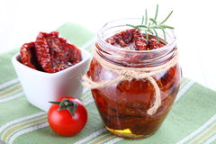 Sun dried tomatoes with olive oil in a jar Stock Photo