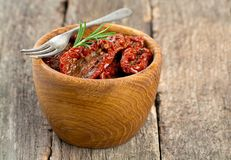 Sun dried tomatoes with olive oil Stock Image