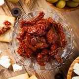 Sun dried tomatoes with olives Stock Images