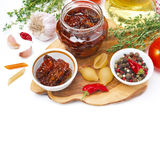 Sun dried tomatoes, pasta and spices on wooden board,  Stock Photography