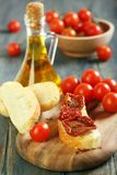 Sun-dried tomatoes on a piece ciabatta. Stock Photos