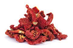 Sun-dried tomatoes. A pile of sun-dried tomatoes on a white background Royalty Free Stock Photos