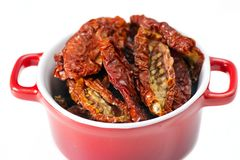 Sun-dried tomatoes in a pot Royalty Free Stock Photo