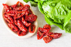 Sun dried tomatoes and salad Stock Image