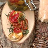 Sun dried tomatoes. On a wood piece Royalty Free Stock Photos