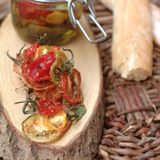 Sun dried tomatoes. On a wood piece Stock Photo