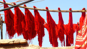 Sun drying dyed wool in Marrakesh. Dyed wool being hung out to dry in the sunshine in Marrakesh, Morocco Royalty Free Stock Photo