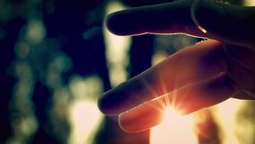 Sun Dust. High speed POV shot of waving fingers through sun rays and dust stock video
