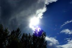 Sun e nubi Fotografia Stock