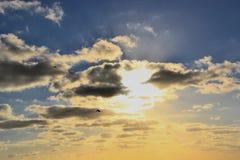 Sun e nuvole Immagine Stock