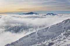 Sun e nuvole in cima di Kasprowy Wierch di Zakopane in Tatras dentro Fotografia Stock Libera da Diritti