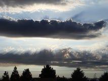 Sun e nuvole surreali Immagini Stock