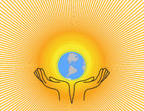 Sun earth. Globe against the sun, symbolically all in hands of people Stock Photography