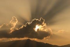 Sun eaten by cloud. Sunset, sun behind the cloud Stock Image