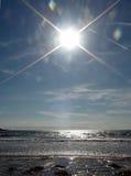 The Sun ed il mare Fotografia Stock