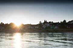 Sun ed il villaggio Fotografie Stock