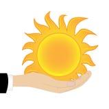 Sun in einer Hand auf einem weißen Hintergrund Stockbilder