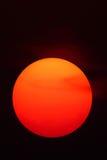 Sun en el cielo de la puesta del sol del resplandor Imágenes de archivo libres de regalías