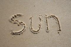 Sun en la arena Fotos de archivo