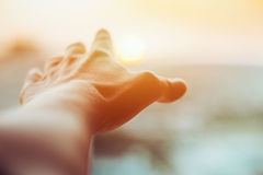 Sun en la mano Foto de archivo