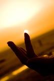 Sun en la yema del dedo Foto de archivo libre de regalías