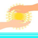 Sun en manos acerca al agua Imágenes de archivo libres de regalías