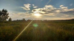Sun en nuages Photographie stock