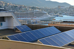 Sun_energy in the city. Solar panels installed on the roof of a building Stock Images