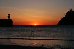 Sun faling into the ocean Stock Photos