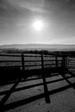 Sun, fence, south downs, countryside, black and white Royalty Free Stock Photography