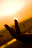 Sun at the fingertip Royalty Free Stock Photo