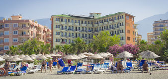 Sun fire beach hotel in Kemer Turkey, may. Beach of Sun fire beach hotel in Kemer (Turkey). A Sunny day in may 2013. On the beach sunbathing guests, which owns Stock Photography