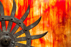 Sun Fire. An old blade with stained glass background Royalty Free Stock Photos