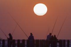 Sun Fishermen Silhouetted Stock Image