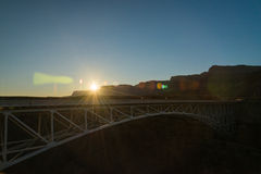 Sun flare brust on the Navajo bridge in Sunset view. 2 Royalty Free Stock Photo