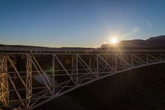 Sun flare brust on the Navajo bridge in Sunset view. 1 Royalty Free Stock Photography