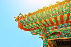 Sun flare above rooftop of some buddhist monastery located near Seoul - South Korea Stock Images