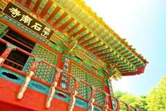 Sun flare over rooftop of some buddhist monastery located near Seoul - South Korea Stock Image