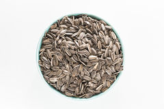 Sun flower seed on bowl. In  white isolated Royalty Free Stock Photo