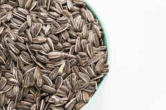 Sun flower seed on bowl. In  white isolated Stock Photos
