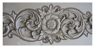 Sun flower statue with thai style art crafting  on white background, stone carving sculpture of flower,home decoration Stock Photo