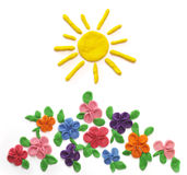 The sun and flowers. Which are moulded from plasticine Stock Photo