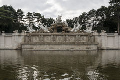 The Sun Fountain. In the Gardens of Schönbrunn Palace. The sculpted garden space between the palace and  is called the Great Parterre. The French garden, a royalty free stock photography