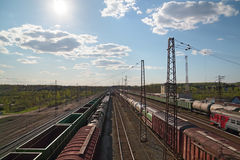 Sun and freight trains at railway station Stock Photography