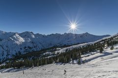 Sun and frost on the ski slope. Skiers on the ski slope, perfect weather for skiing, sun and frost Stock Photography