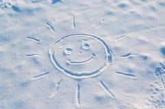 Sun gezeichnet in den Schnee Lizenzfreie Stockfotografie